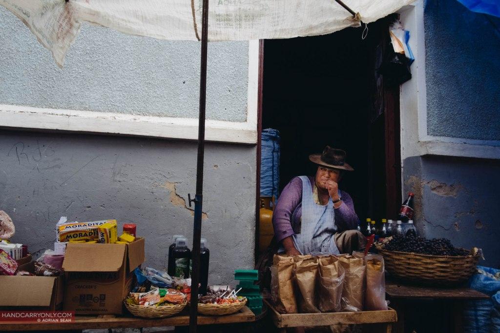 Lady vendor with wares Tarabuco Bolivia