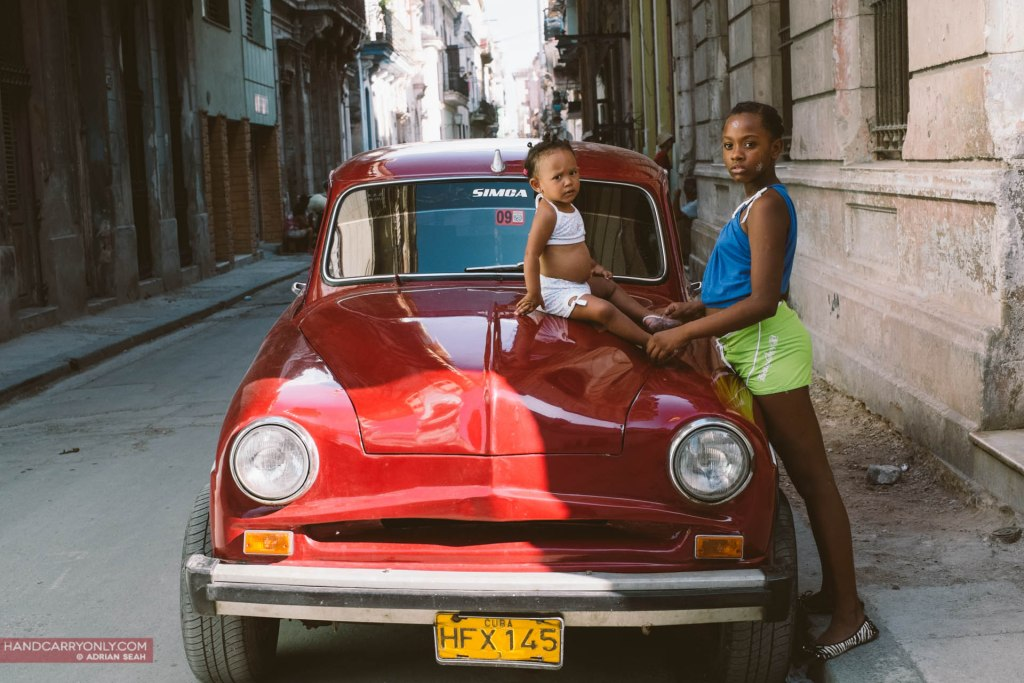 two sisters red car havana cuba
