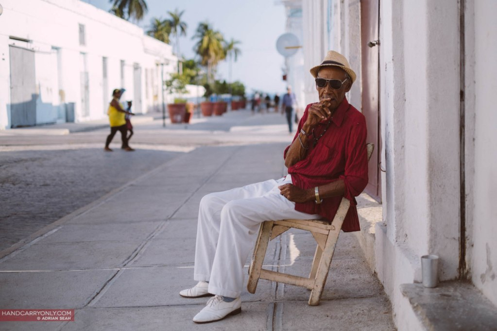 old man smoking cigar in cuba