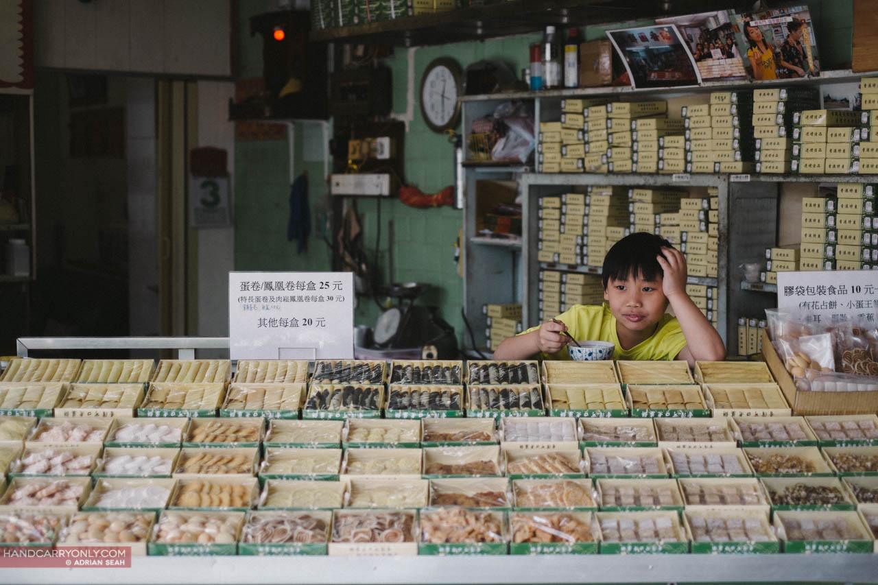 boy at a snack stall hong kong