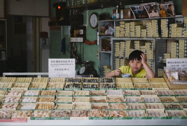 boy at a snack stall hong kong