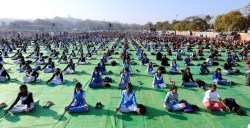 epa06432514 Indian school children perform Yoga exercises as they participate in a mass 'Surya Namaskar' program on the occasion of the 155th birthday anniversary of Swami Vivekanand, marking the National Youth Day, in Bhopal, India, 12 January 2018. The program is being organized in all schools of the state as per directives of the Madhya Pradesh school education department.  EPA/SANJEEV GUPTA