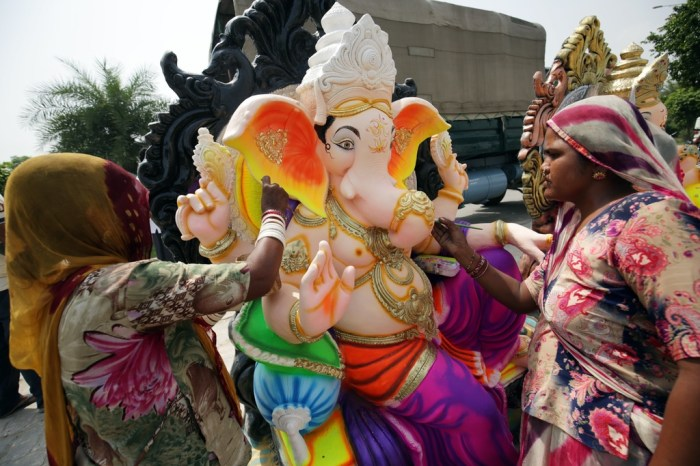 epa07016753 Indian artists touch up an idol of the elephant-headed Hindu God Ganesha at a workshop during Ganesh Chaturthi festival in Amritsar, India, 13 September 2018. Ganesha Chaturthi or Ganesha Festival is a day on which Lord Ganesha, the son of Shiva and Parvati, is believed to bestow his presence on earth for all his devotees. It is celebrated as the birthday of Lord Ganesha. The festival is observed in the Hindu calendar month of Bhaadrapada, starting on the Shukla Chaturthi (fourth day of the waxing moon period).  EPA/RAMINDER PAL SINGH