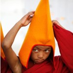 Buddhist Child Wearing Pyramid Shaped Hat