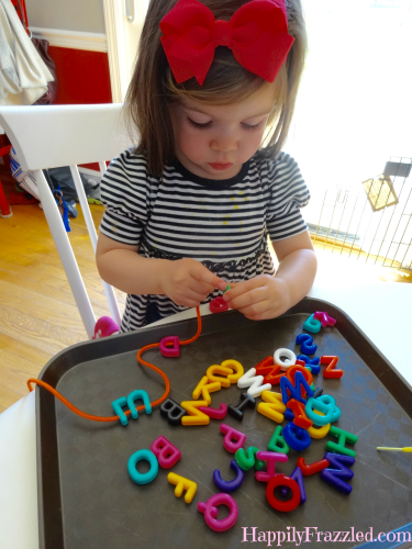 Stringing Letter Beads for an Indoor and Rainy Day Toddler Activity | HappilyFrazzled.com