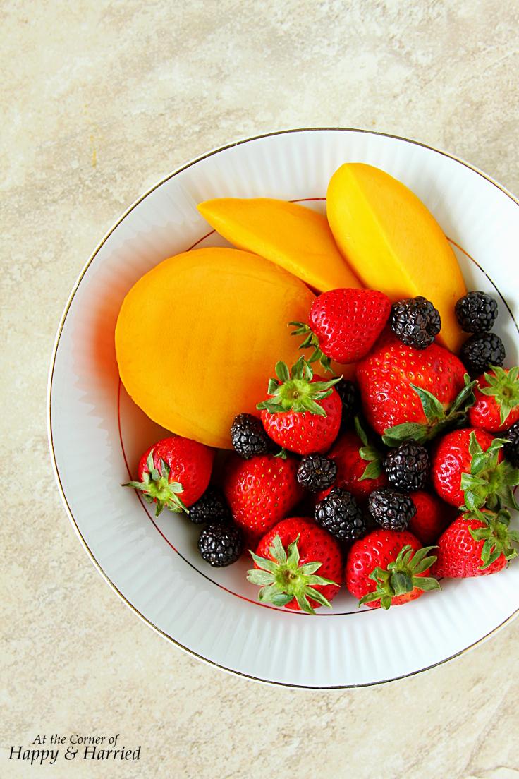mango lassi and strawberries and blackberries to make berry lassi