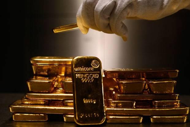 emas global tergelincir harga emas antam stagnan
