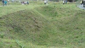 One of the craters at Pointe du Hoc created by bombs during World War II.