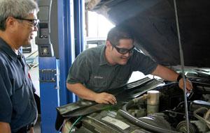 student mechanic under hood