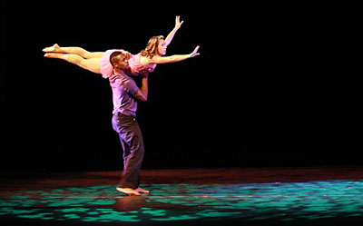 two people dancing on stage
