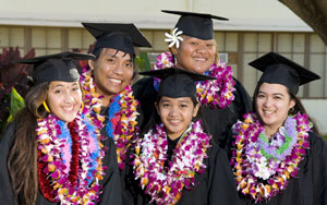 students in graduation garb and lei
