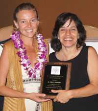 two women holding award