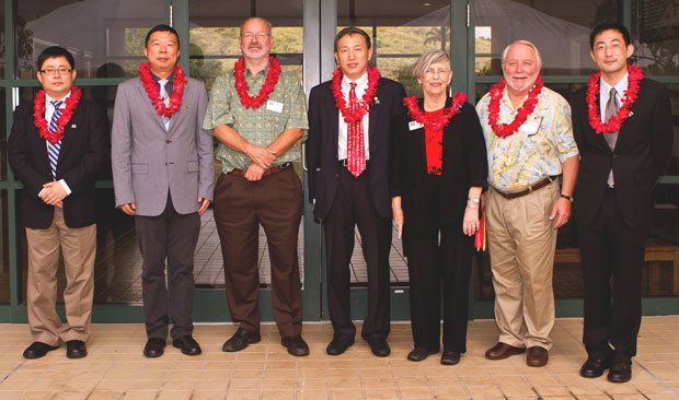 group of people wearing red lei