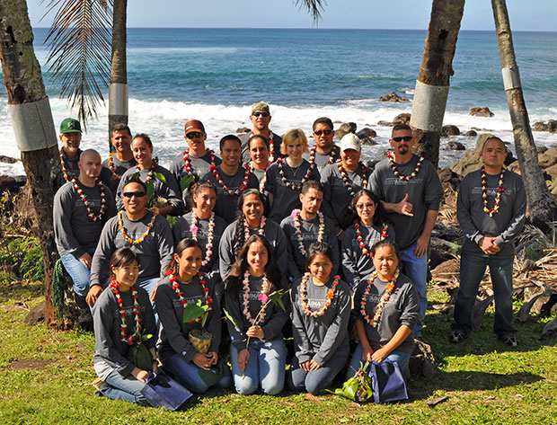 Group of students with lei on beach