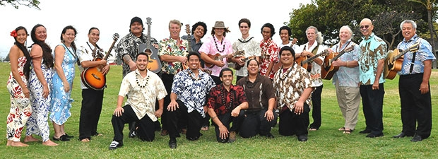 Group of people in aloha attire with instruments