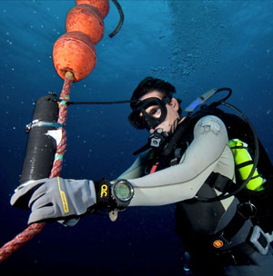 Researcher checks underwater listening station.