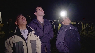 From left, Wayne Shiroma, Larry Martin and Windell Jones watch the Minotaur rocket, carrying their CubeSat, launch at NASA's Wallops Flight Facility.