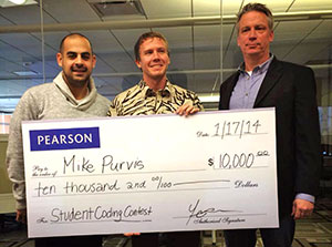 3 people holding big check