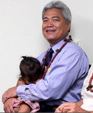 man holding granddaughter