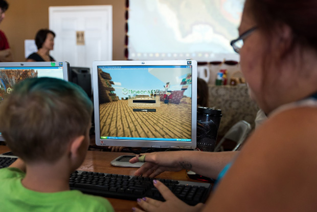 Child and parent playing Minecraft