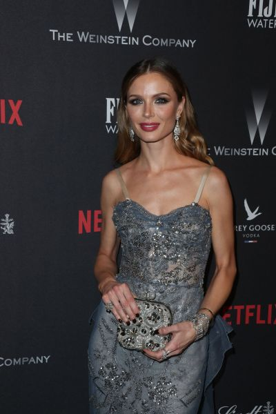GEORGINA CHAPMAN at Weinstein Company and Netflix Golden Globe Party in Beverly Hills 01/08/2017 ...