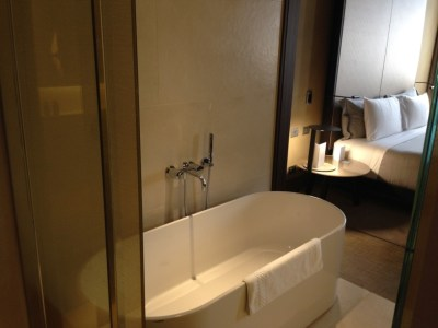 ME Milan room bathtub bed