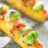 Grilled Corn On The Cob Loaded With Brussels Sprouts