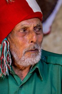 Bearded Nepalese man with red fez
