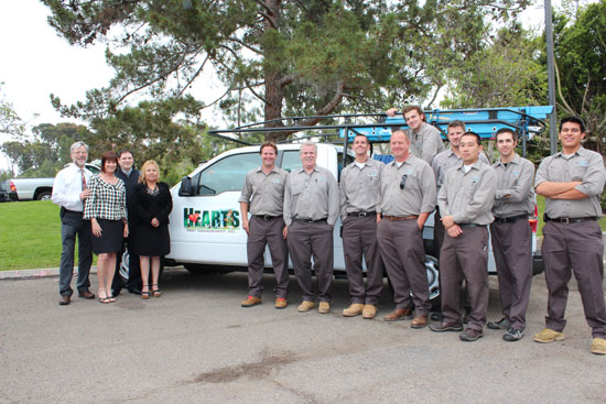 Hearts Pest Management team photo alongside pest control vehicle