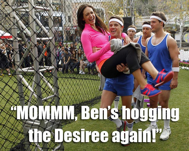Ben carries Desiree around the dodge ball after the blue team wins on the BAchelorette.