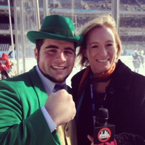 Lisa Kelly and Leprechaun Johnny rink side at Soldier Field.