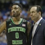 Eric Atkins and Mike Brey look on as the Irish fall to Wake Forrest in the ACC tournament. (AP Photo/Gerry Broome)
