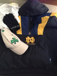 The ND gear left at my door, trash bag included. Not pictured, a gold ND beanie I found later in the jacket pocket.