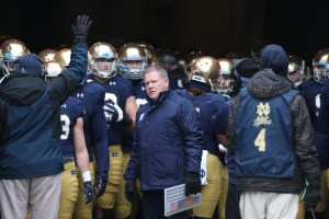 Notre Dame Fighting Irish coach Brian Kelly leads the team onto the filed before the against the Northwestern at Notre Dame Stadium. (Brian Spurlock-USA TODAY Sports)