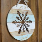 let it snow wooden snowflake feature