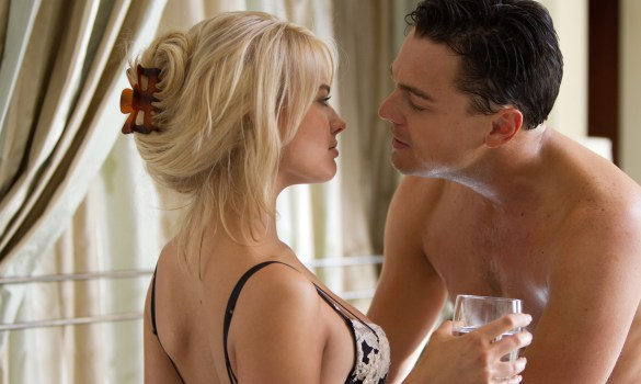 Margot Robbie and Leonardo DiCaprio in The Wolf of Wall Street 585x350 Leonardo DiCaprio and Margot Robbie Strip Down in New Images from The Wolf of Wall Street