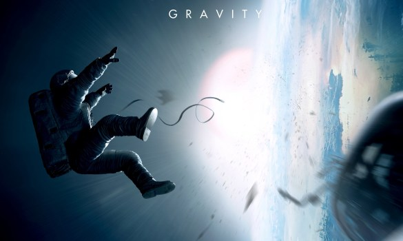 2013 gravity movie wide 585x350 Movie Bloggers Top Ten: Gravity Voted Best Film of 2013 By Online Community