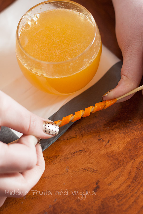 Here's an example of how Kelly made the orange twists for our drinks in case you don't happen to have the right kind of peeler for the job!