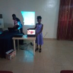 Girl Child presenting her project