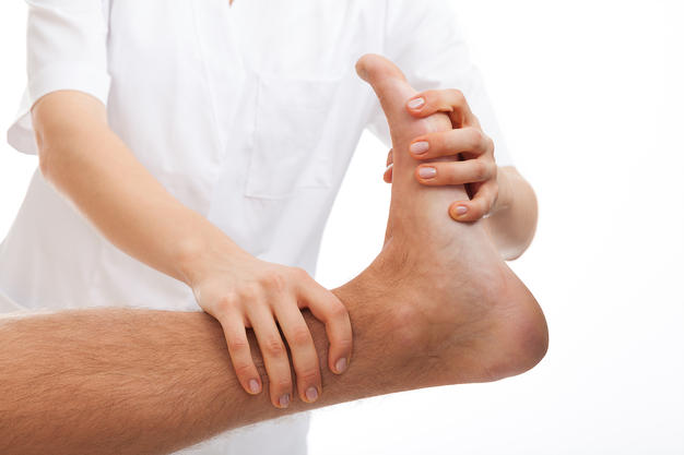 Phisiotherapist making a foot rehabilitation in physiotherapy clinic