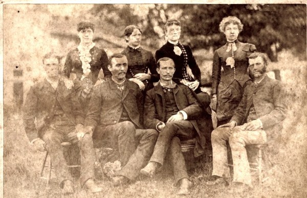 Family of William L. and Amanda (Walker) Hill. (LeMaster) Hill. Left to Right: Clay Meal Hill, Mattie Van Cleeve Hill, Richard Tidrick, Elizabeth Arminta Hill Tidrick, George Elzy Hill, Fitzhugh Watkins Hill, Mattie LaMaster Hill, Horace William Hill.