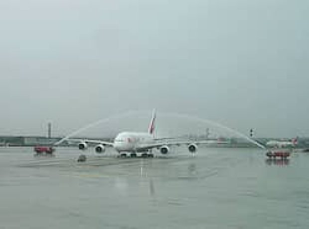 Emirates Airbus A380 from Dubai getting a water cannon salute.