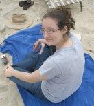 V E Duncan on beach