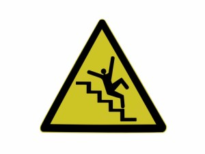 caution sign with man falling down stairs