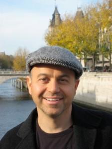 alan watt in hat in front of lake