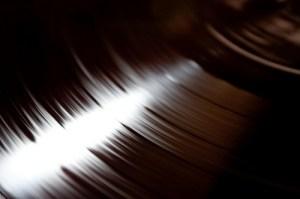 close up of vinyl record spinning