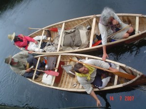 ken and three others in 18th century canoes