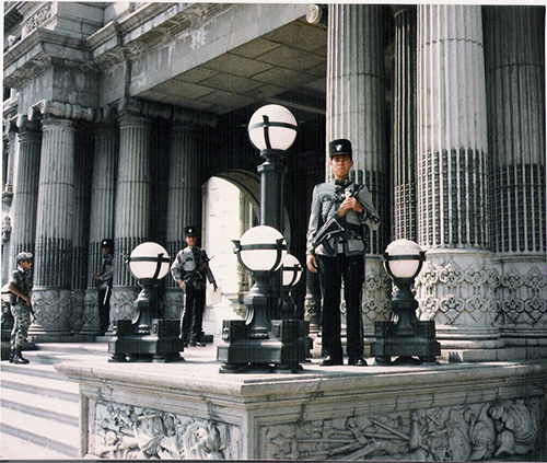 soldiers stand guard in Guatemala photo copyright john f. miglio