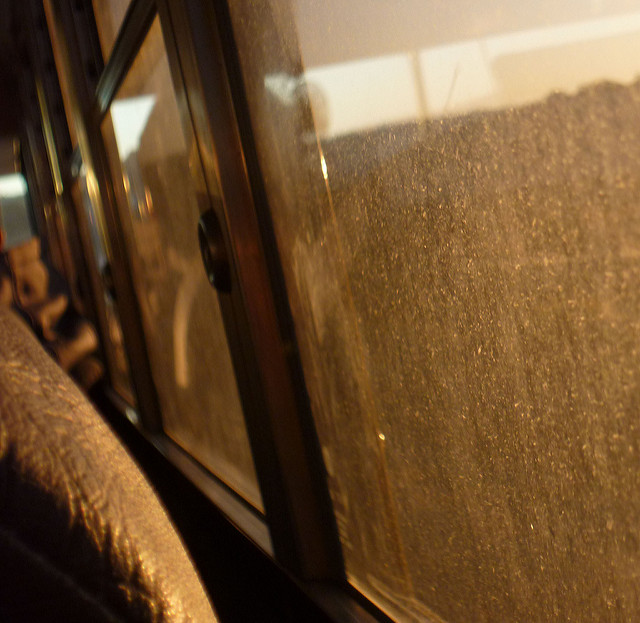 close up of school bus window looking out - dirty