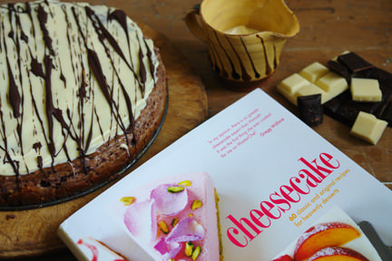 """Cheesecake"" book by Hannah Miles with chocolate & ginger cheesecake and little jug of creme fraiche and squares of dark & white chocolate"